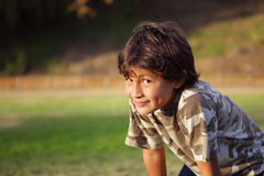 Happy smiling boy in the park near to sunset Stock Photography