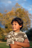 Happy smiling boy in the park near to sunset Royalty Free Stock Photos