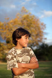 Happy smiling boy in the park near to sunset Stock Images