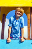 Happy smiling boy at a playground Stock Photos