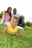 Happy smiling Boy Playing Outdoor with Parents Stock Photo
