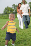 Happy Smiling Boy Playing Outdoor with Parents Royalty Free Stock Photos