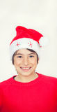 Happy smiling boy with red sweater and Christmas hat, isolated o Royalty Free Stock Images