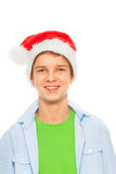 Happy smiling boy in Santa Christmas hat Stock Image
