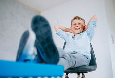 Happy smiling boy sits in new apartment Royalty Free Stock Photos
