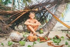 Happy smiling boy sits in selfmade hut Stock Image