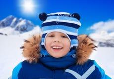 Happy smiling boy on snow day Stock Photo