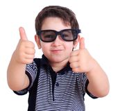 Happy smiling boy in sunglasses showing thumbs up gesture, close stock image