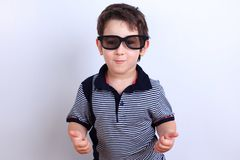 Happy smiling boy in sunglasses showing thumbs up gesture, studi royalty free stock photos