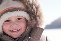 Happy smiling boy in winter clothes.  royalty free stock photo