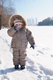 Happy smiling boy in winter clothes.  royalty free stock photography