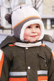 Happy smiling boy in winter clothes Stock Images