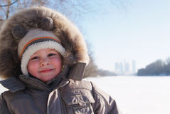 Happy smiling boy in winter clothes Royalty Free Stock Image