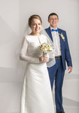 Happy smiling bride posing with white roses at studio Royalty Free Stock Images