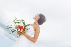 Happy smiling bride on the wedding day on tropical beach an Royalty Free Stock Image
