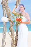 Happy smiling bride on the wedding day on tropical beach an Royalty Free Stock Photos