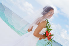 Happy smiling bride on the wedding day on tropical beach an Stock Image