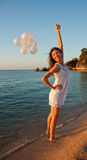 Happy smiling brunette on sunny beach Royalty Free Stock Images