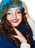Happy Smiling Brunette wearing Knitted Blue Cap and Jersey Stock Photo