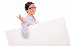 Happy smiling brunette woman carrying placard Stock Photo