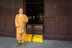 Happy smiling Buddhist monk in China Stock Image