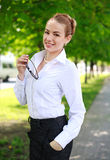 Happy smiling business lady in white shirt Royalty Free Stock Image