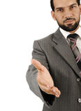 Happy smiling business man giving hand for handshake Stock Image