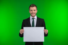 Happy smiling business man holding blank signboard. Royalty Free Stock Photo
