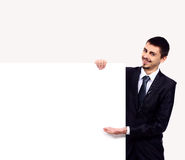 Happy smiling business man showing blank signboard Stock Images