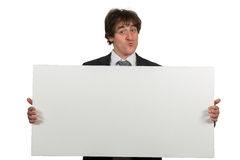 Happy smiling business man showing blank signboard, isolated over white background Royalty Free Stock Photo