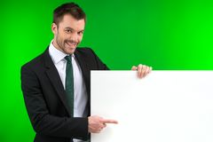 Happy smiling business man showing blank signboard. Stock Photography