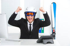 Happy smiling business man in ski hamlet and mask. Royalty Free Stock Photos