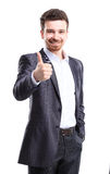 Happy smiling business man with thumbs up gesture. Happy smiling young business man with thumbs up gesture, isolated over white background royalty free stock photo