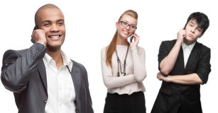 Happy smiling business people calling by mobile telephone Stock Image