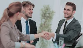 Business people closing a deal and handshaking at the office Royalty Free Stock Images