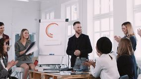 Happy smiling business people team clap to middle aged coach businessman at office seminar. Slow motion RED EPIC-W. Happy smiling business people team clap to stock footage