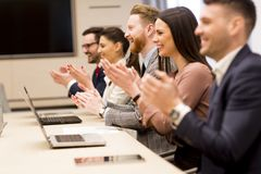 Happy smiling business team clapping hands. During a meeting in the office Royalty Free Stock Photography
