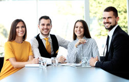 Happy smiling business team in office Stock Image