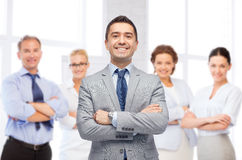 Happy smiling business team over office room Stock Photography