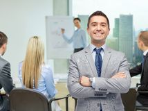 Happy smiling business team over office room Stock Image