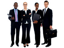 Happy smiling business team standing in a row. Isolated over white Royalty Free Stock Image