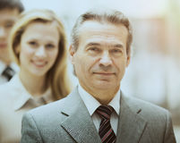 Happy smiling business team standing in a row Stock Photos