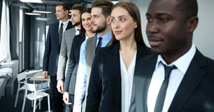 Happy smiling business team standing in a row at office. Royalty Free Stock Photo