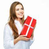 Happy smiling business woman hold red gift. white background is Stock Images