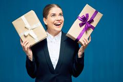 Happy smiling business woman holding gift boxes. Stock Images