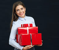 Happy smiling business woman holding red gift boxes Royalty Free Stock Photos