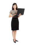 Smiling business woman with laptop Stock Photo