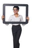 Happy smiling business woman looking through frame Stock Image