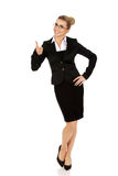 Happy smiling business woman with ok hand sign Stock Photos