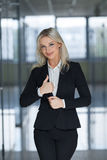 Happy smiling business woman with ok hand sign. Stock Photography